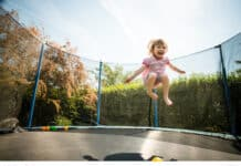 Little child on trampoline